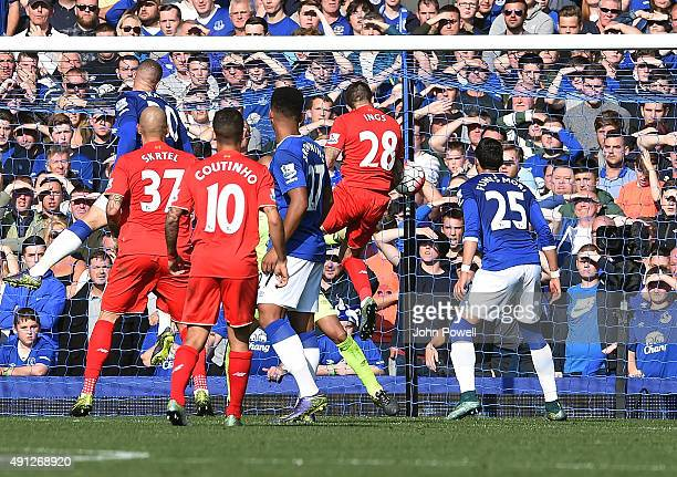 Danny Ings of Liverpool scores the opening goal during the Barclays Premier League match between Everton and Liverpool on October 04 2015 in...