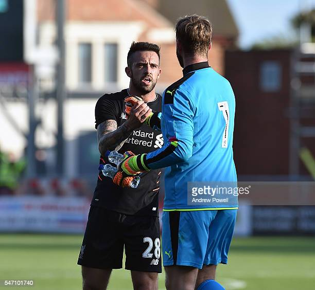 Danny Ings of Liverpool shakes hands Chris Neal of Fleetwood Town at the end of the PreSeason Friendly match bewteen Fleetwood Town and Liverpool at...