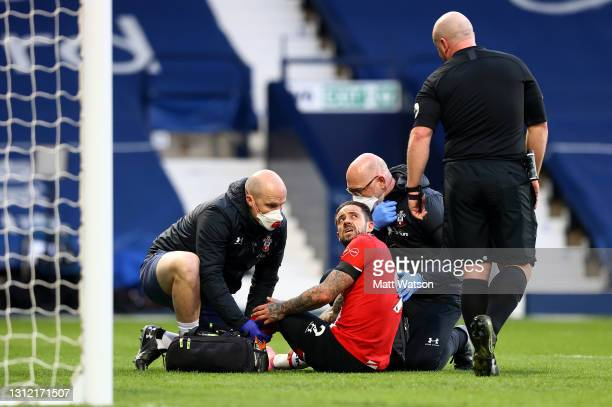 Danny Ings of receives treatment from club medical staff during the Premier League match between West Bromwich Albion and Southampton at The...