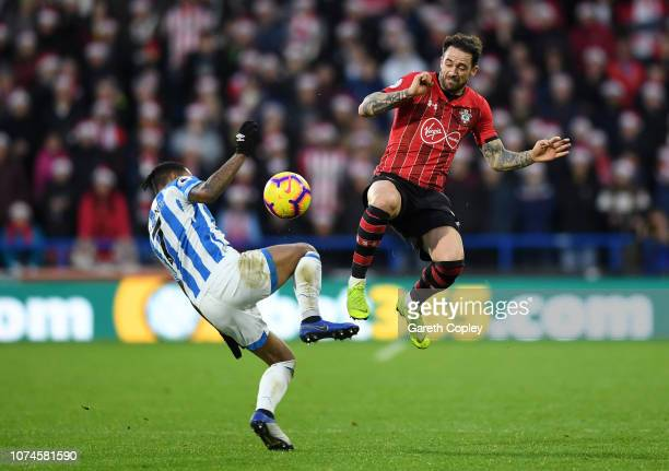 Danny Ings of Southampton and Beram Kayal of Brighton and Hove Albion battles for possession in the air during the Premier League match between...