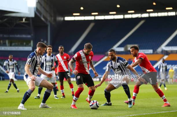Danny Ings of Southampton battles for possession with Dara O'Shea and Matt Phillips of West Bromwich Albion during the Premier League match between...