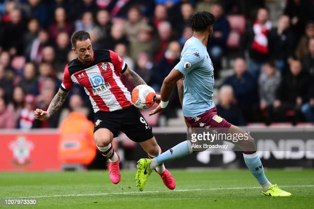 Danny Ings of Southampton battles for possession with Tyrone Mings of Aston Villa during the Premier League match between Southampton FC and Aston...