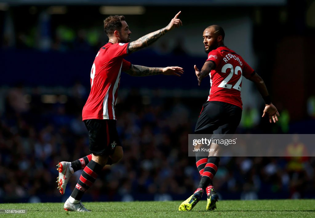 Danny Ings of Southampton celebrates after scoring his team's first goal with team mate Nathan Redmond during the Premier League match between Everton FC and Southampton FC at Goodison Park on August 18, 2018 in Liverpool, United Kingdom.
