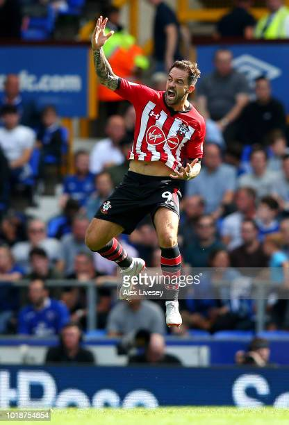 Danny Ings of Southampton celebrates after scoring his team's first goal during the Premier League match between Everton FC and Southampton FC at...