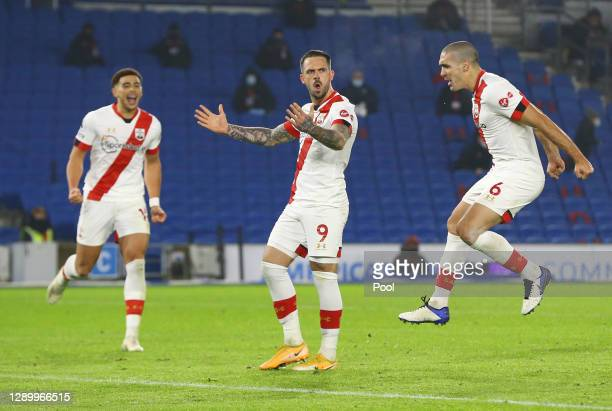 Danny Ings of Southampton celebrates after scoring their sides second goal from the penalty spot with Che Adams of Southampton and Oriol Romeu of...