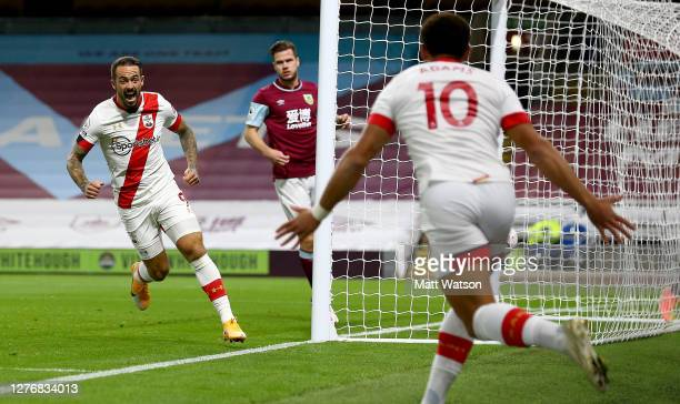 Danny Ings of Southampton celebrates with Ché Adams after opening the scoring during the Premier League match between Burnley and Southampton at Turf...
