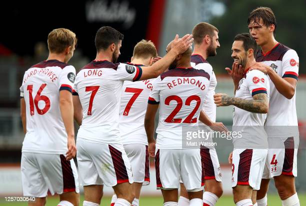 Danny Ings of Southampton celebrates with his team mates during the Premier League match between AFC Bournemouth and Southampton FC at Vitality...