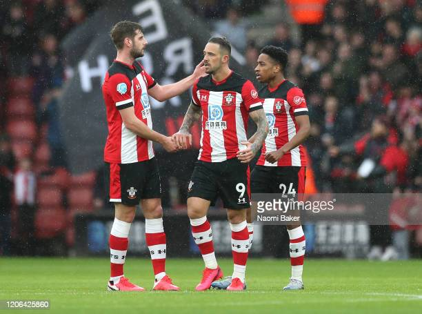 Danny Ings of Southampton celebrates with Jack Stephens and Kyle WalkerrPeters after scoring his team's first goal during the Premier League match...