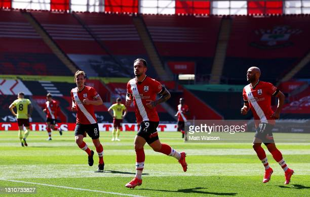 Danny Ings of Southampton celebrates with James Ward-Prowse and Nathan Redmond during the Premier League match between Southampton and Burnley at St...