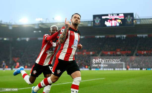Danny Ings of Southampton celebrates with Moussa Djenepo after scoring during the Premier League match between Southampton FC and Tottenham Hotspur...
