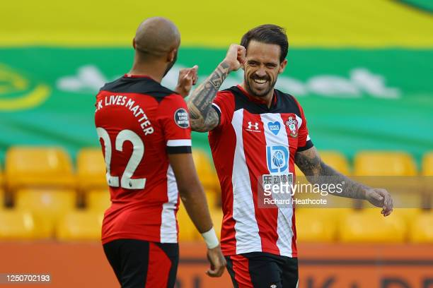 Danny Ings of Southampton celebrates with Nathan Redmond after scoring his team's first goal during the Premier League match between Norwich City and...
