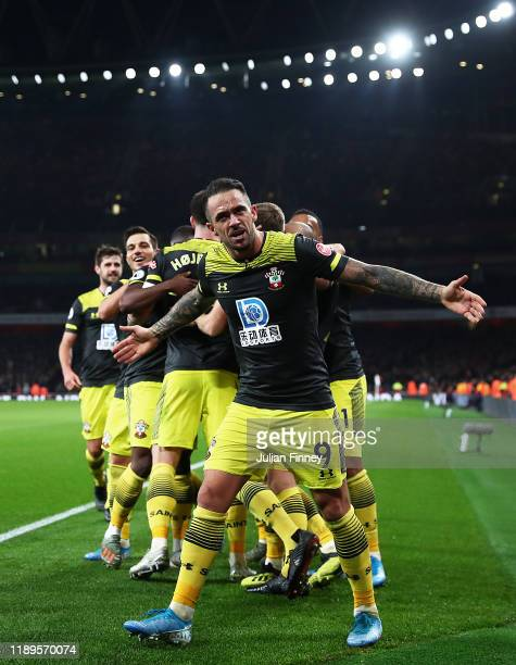 Danny Ings of Southampton celebrates with players after their teams second goal during the Premier League match between Arsenal FC and Southampton FC...