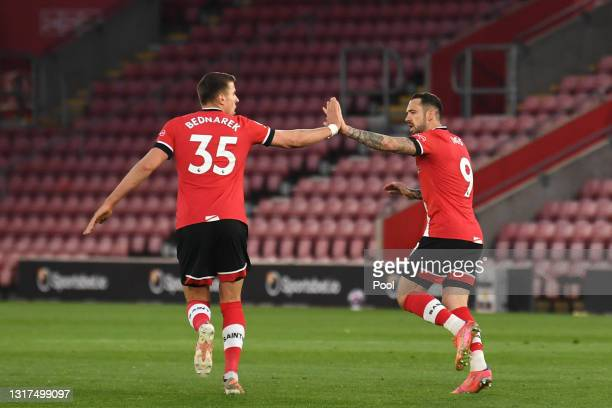 Danny Ings of Southampton celebrates with team mate Jan Bednarek after scoring their side's first goal during the Premier League match between...