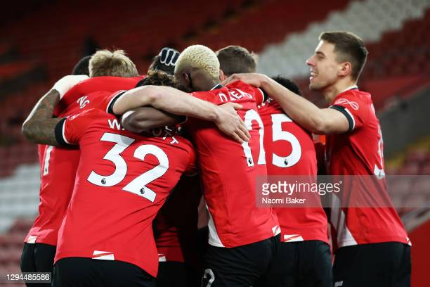 Danny Ings of Southampton celebrates with team mates after scoring their team's first goal during the Premier League match between Southampton and...