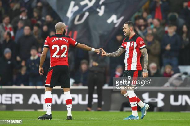 Danny Ings of Southampton celebrates with teammate Nathan Redmond after scoring his team's first goal during the Premier League match between...