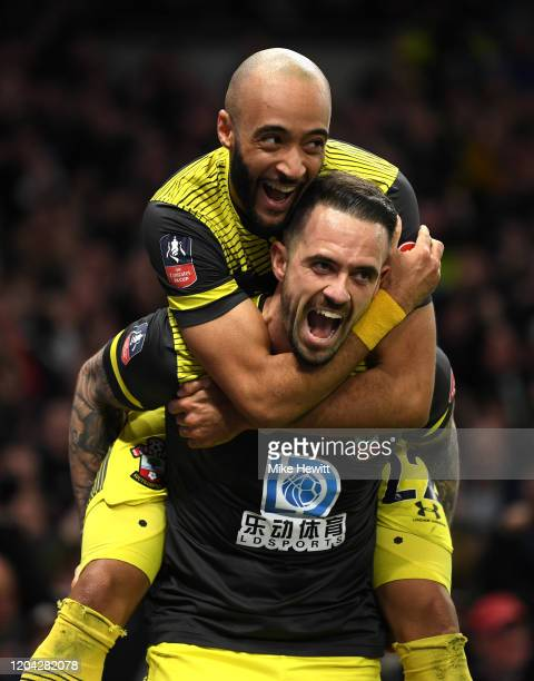 Danny Ings of Southampton celebrates with teammate Nathan Redmond after scoring their sides second goal during the FA Cup Fourth Round Replay match...