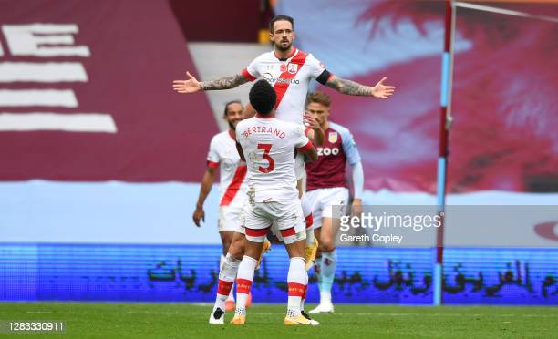 Danny Ings of Southampton celebrates with teammate Ryan Bertrand after scoring his team's fourth goal during the Premier League match between Aston...