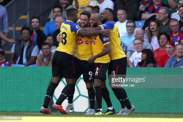 Danny Ings of Southampton celebrates with teammates after scoring his team's first goal during the Premier League match between Crystal Palace and...