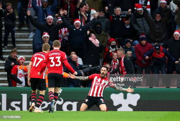 Danny Ings of Southampton celebrates with teammates after scoring his team's first goal during the Premier League match between Southampton FC and...