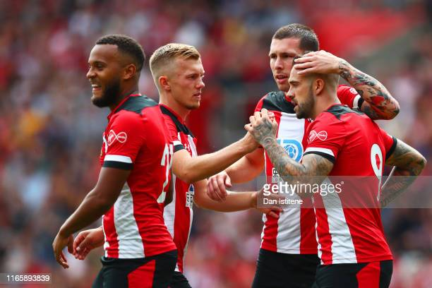 Danny Ings of Southampton celebrates with team-mates after scoring his team's first goal from the penalty during the Pre-Season Friendly match...