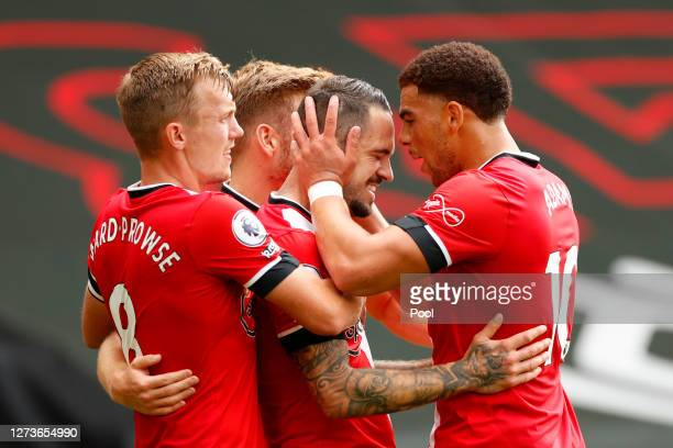 Danny Ings of Southampton celebrates with teammates after scoring his team's first goal during the Premier League match between Southampton and...