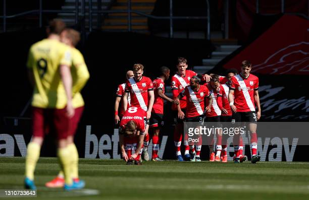 Danny Ings of Southampton celebrates with teammates after scoring their team's second goal during the Premier League match between Southampton and...
