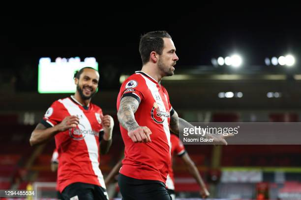 Danny Ings of Southampton celebrates with Theo Walcott after scoring their team's first goal during the Premier League match between Southampton and...