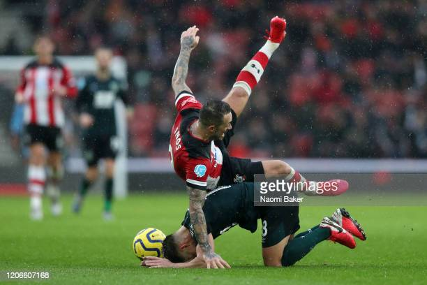 Danny Ings of Southampton collides with Ashley Westwood of Burnley during the Premier League match between Southampton FC and Burnley FC at St Mary's...
