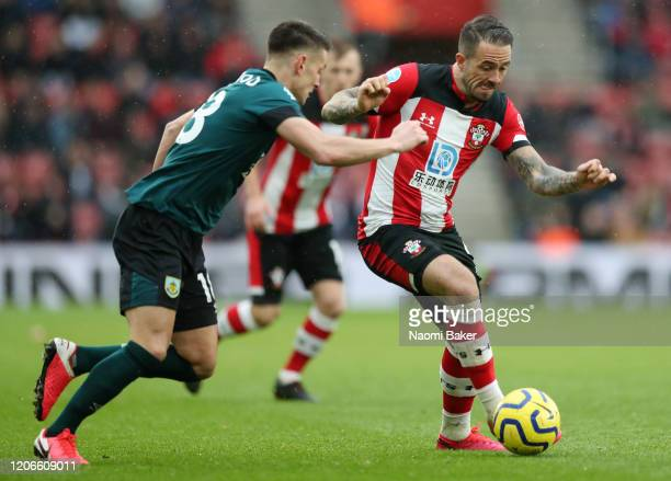 Danny Ings of Southampton controls the ball as Ashley Westwood of Burnley looks on during the Premier League match between Southampton FC and Burnley...