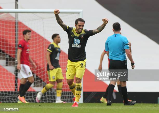 Danny Ings of Southampton FC celebrates Stuart Armstrong scoring their first goal during the Premier League match between Manchester United and...