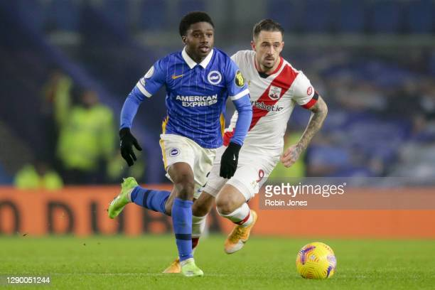 Danny Ings of Southampton gives chase to Tariq Lamptey of Brighton & Hove Albion during the Premier League match between Brighton & Hove Albion and...