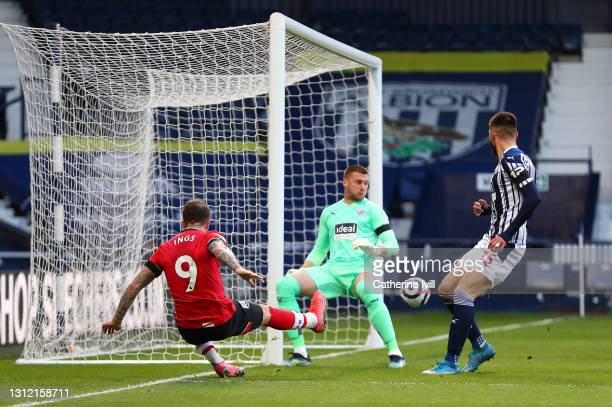 Danny Ings of Southampton has a shot on goal whilst under pressure from Sam Johnstone of West Bromwich Albion during the Premier League match between...