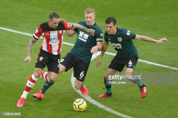 Danny Ings of Southampton holds off Ben Mee and Jack Cork of Burnley before he scores a goal to make it 11 during the Premier League match between...