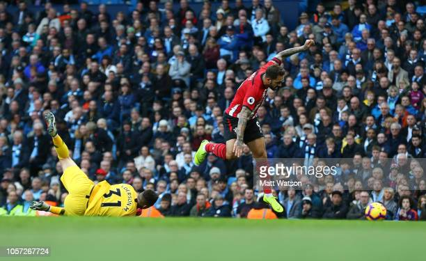 Danny Ings of Southampton is brought down by City keeper Ederson during the Premier League match between Manchester City and Southampton FC at Etihad...