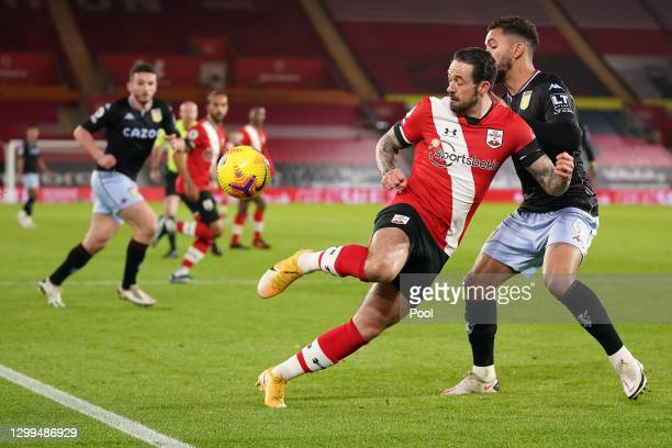 Danny Ings of Southampton is challenged by Douglas Luiz of Aston Villa during the Premier League match between Southampton and Aston Villa at St...