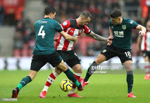 Danny Ings of Southampton is challenged by Jack Cork and Ashley Westwood of Burnley during the Premier League match between Southampton FC and...