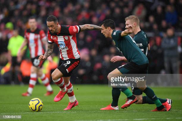 Danny Ings of Southampton is challenged by Jack Cork and Ben Mee of Burnley during the Premier League match between Southampton FC and Burnley FC at...
