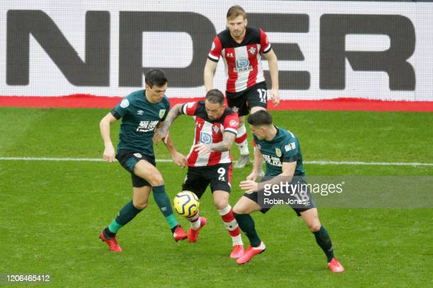 Danny Ings of Southampton is closed down by Jack Cork and Ashley Westwood of Burnley during the Premier League match between Southampton FC and...