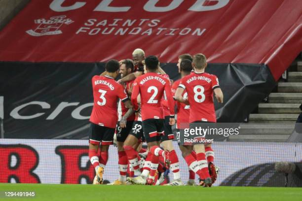 Danny Ings of Southampton is congratulated by team-mates after he scores a goal to make it 1-0 during the Premier League match between Southampton...