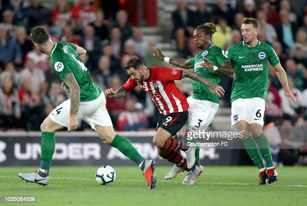 Danny Ings of Southampton is fouled by Gaetan Bong of Brighton and Hove Albion and a penalty is later awarded during the Premier League match between...