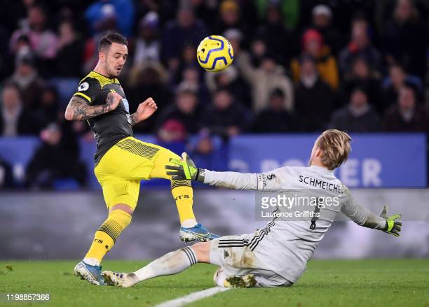 Danny Ings of Southampton is put under pressure by Kasper Schmeichel of Leicester City as he shoots during the Premier League match between Leicester...