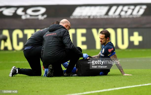 Danny Ings of Southampton receives treatment after picking up an injury during the Premier League match between Sheffield United and Southampton at...