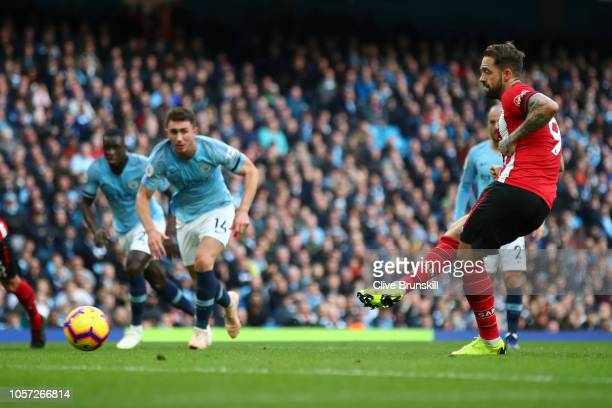 Danny Ings of Southampton scores a penalty for his team's first goal during the Premier League match between Manchester City and Southampton FC at...