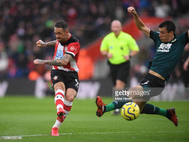 Danny Ings of Southampton scores his team's first goal as Jack Cork of Burnley attempts to block during the Premier League match between Southampton...
