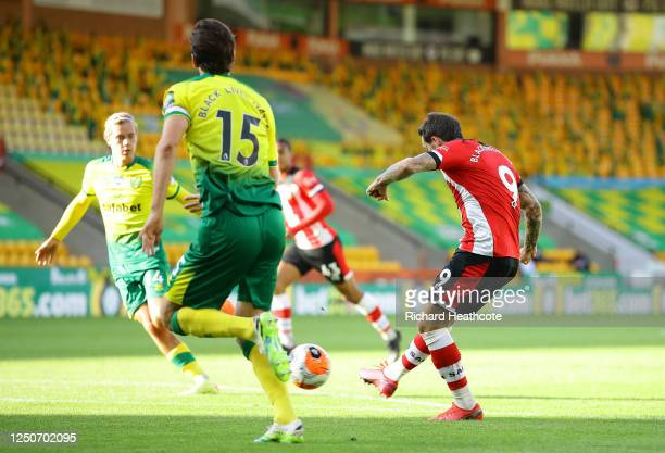 Danny Ings of Southampton scores his teams first goal during the Premier League match between Norwich City and Southampton FC at Carrow Road on June...