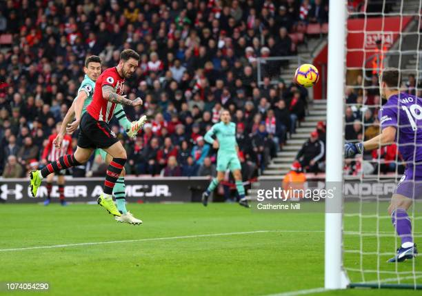 Danny Ings of Southampton scores his team's first goal under pressure from Laurent Koscielny of Arsenal during the Premier League match between...