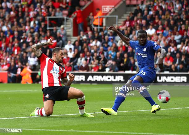 Danny Ings of Southampton scores his team's first goal under pressure from Kurt Zouma of Chelsea during the Premier League match between Southampton...