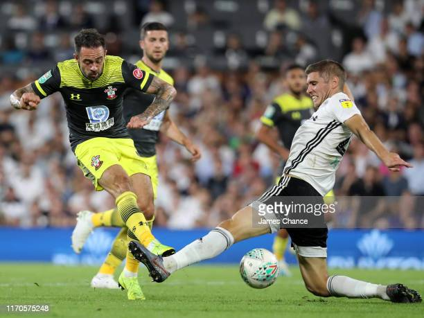Danny Ings of Southampton shoots and misses as Maxime Le Marchand of Fulham attempts to block the ball during the Carabao Cup Second Round match...