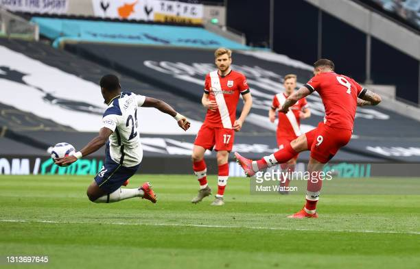 Danny Ings of Southampton shoots at goal, which causes an injury to his hamstring during the Premier League match between Tottenham Hotspur and...