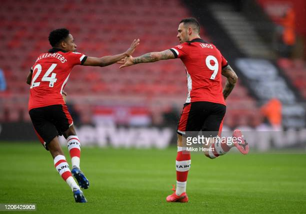 Danny Ings of Southampton with celebrates with Kyle WalkerrPeters after scoring his team's first goal during the Premier League match between...